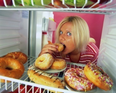 portrait-young-woman-eating-doughnut-the-refrigerator