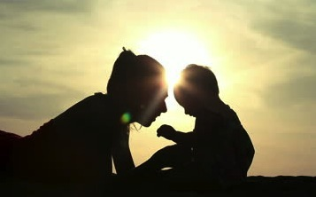stock-footage-silhouette-of-mother-and-daughter-over-sunset