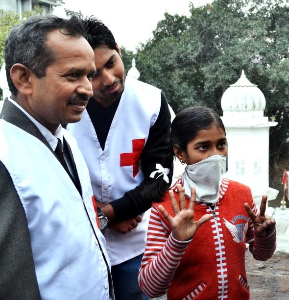 14-year-old Sushi Singh, suffering from MDR TB showing how many pills per day she takes