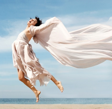 fotolia 454192-Spiritual-woman-jumping-for-joy 0