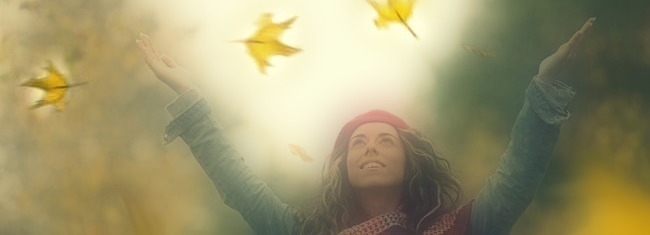 woman throwing dried leaves into air 2