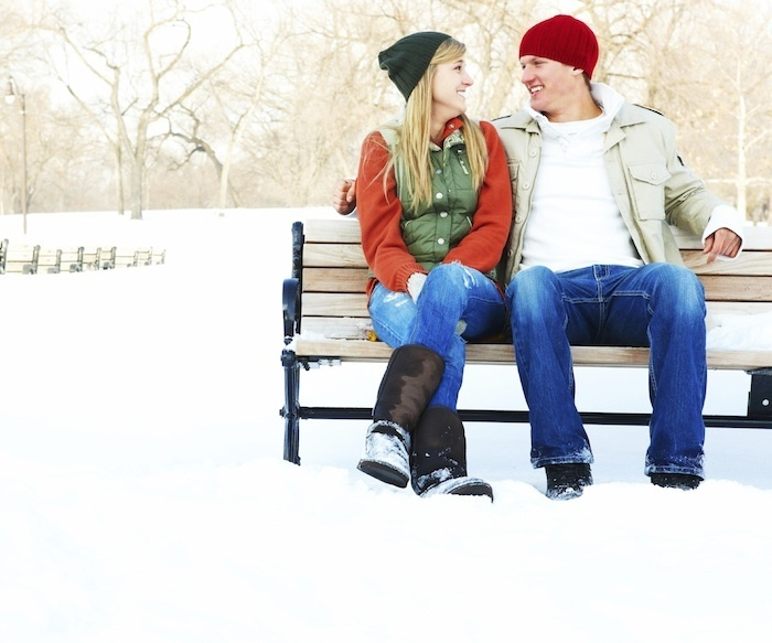 couple on bench in snow
