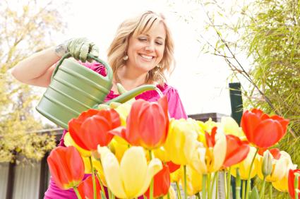 Woman-watering-flowers