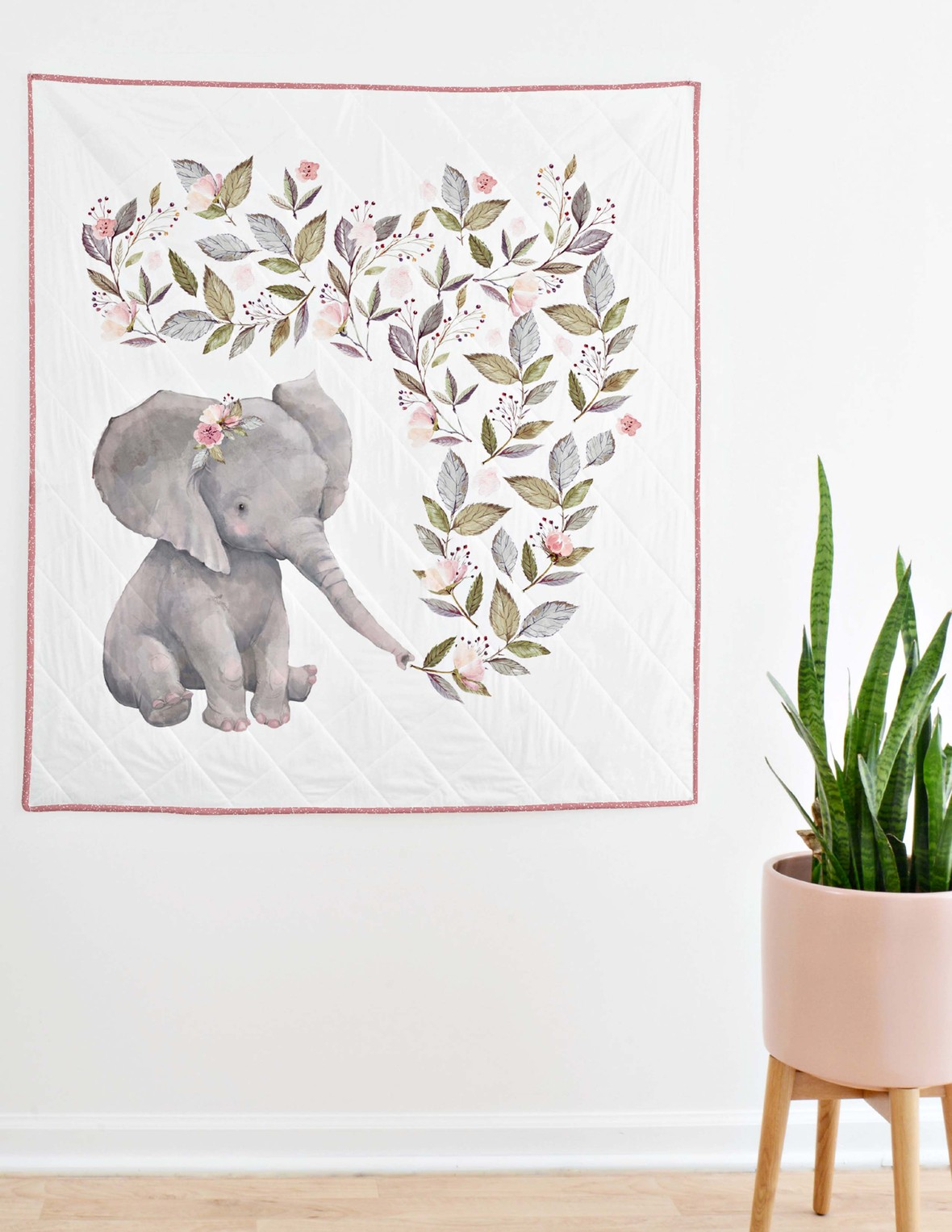 crib quilt hanging with plant elephant panel berry trim