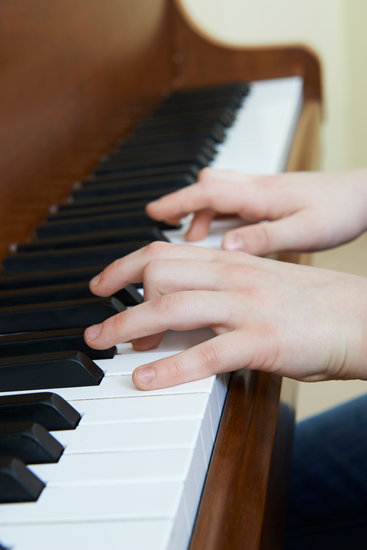canva-close-up-of-child s-hands-playing-piano-MADBU7DnuY4