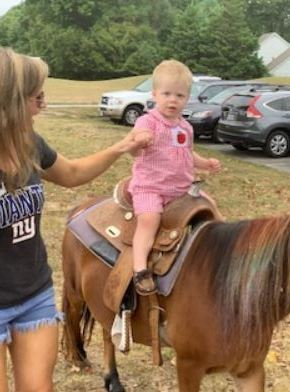 baby on horse