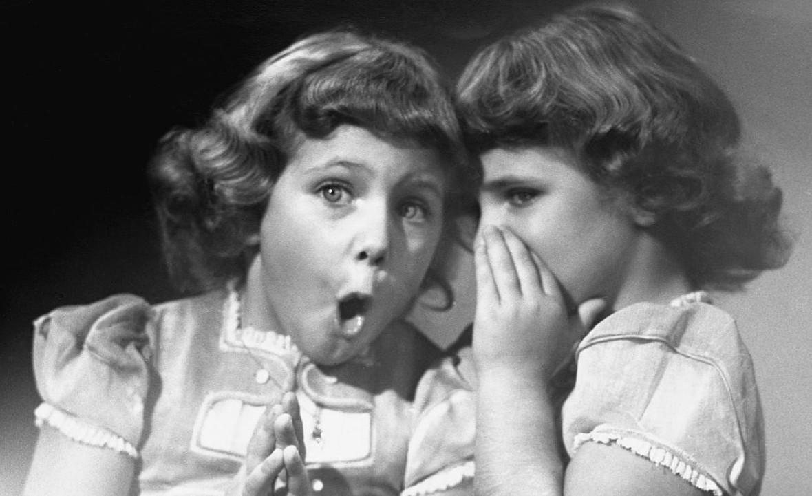 little-girls-telling-secret-shhh