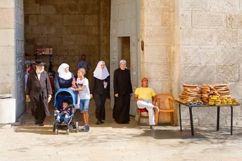 Jew Arab Christian walking down street
