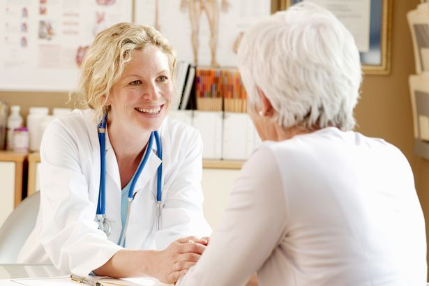 mature woman with doctor