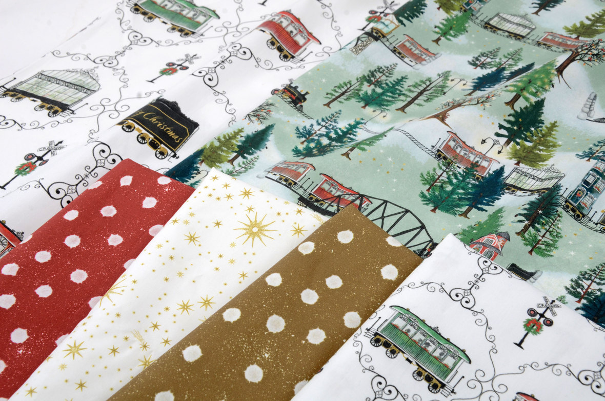 Megan-Martin-At-the-Cottage-Studio-Fabric-Christmas-Trains-Close-Up-at-Hawthorne-Supply-Co