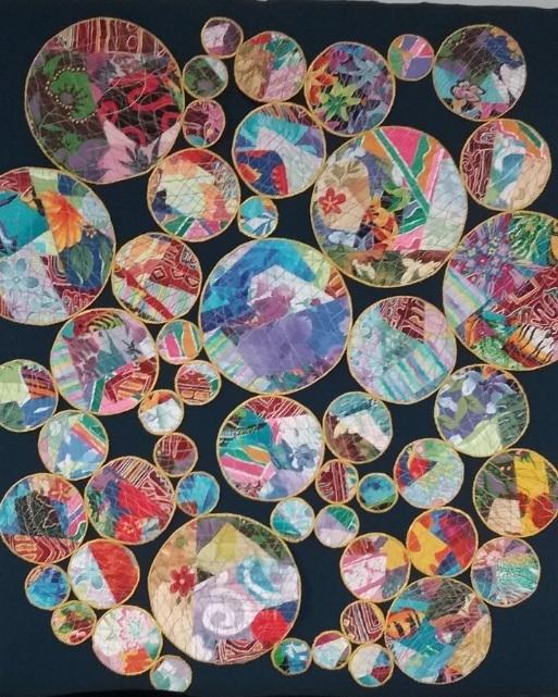 M. Lewis open work art quilt