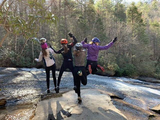 Girls jumping with mtb helmet