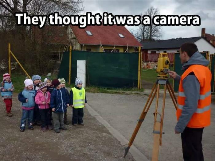kids thought this land surveyor was taking a picture. 9204002618