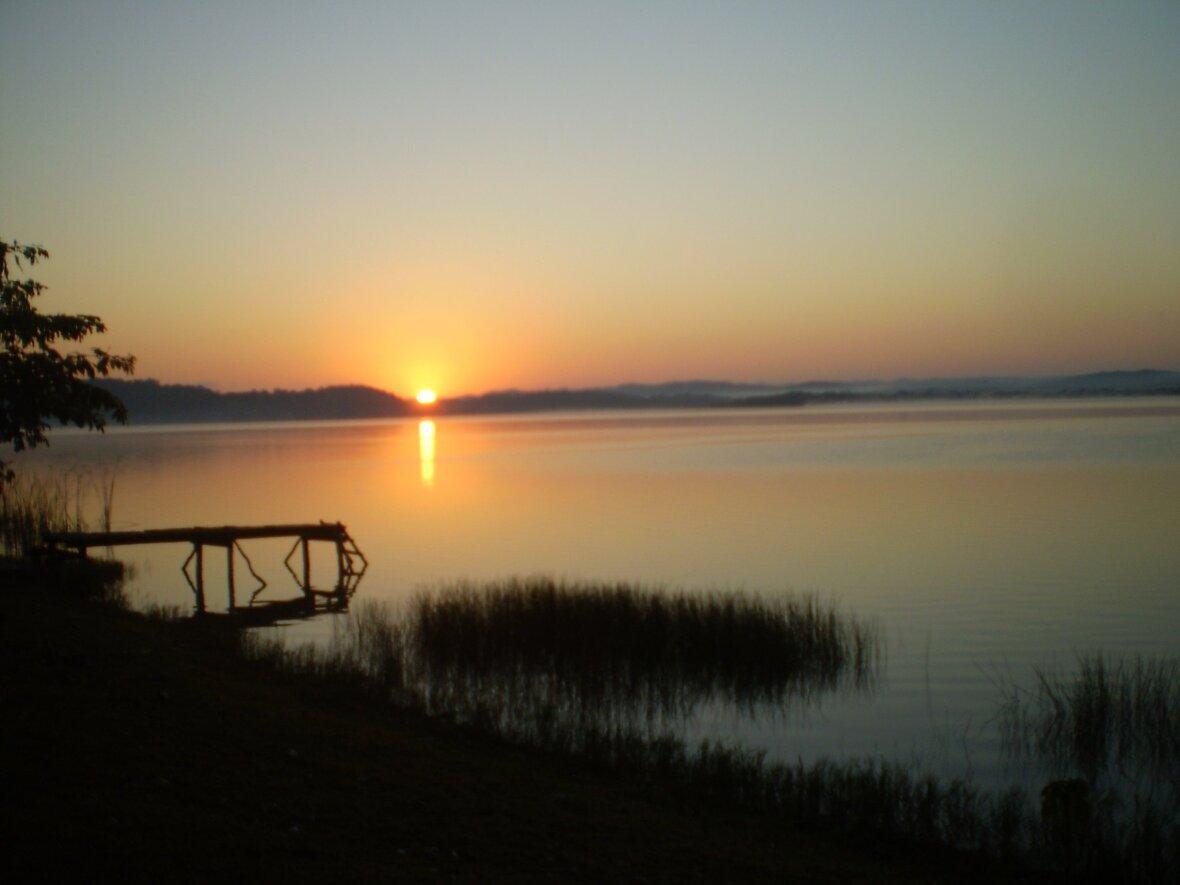 Sunrise Lake Peten Itza - We had a sunrise fire ceremony every morning with the Tatas and Nanas The Maya Elders Dec 2010