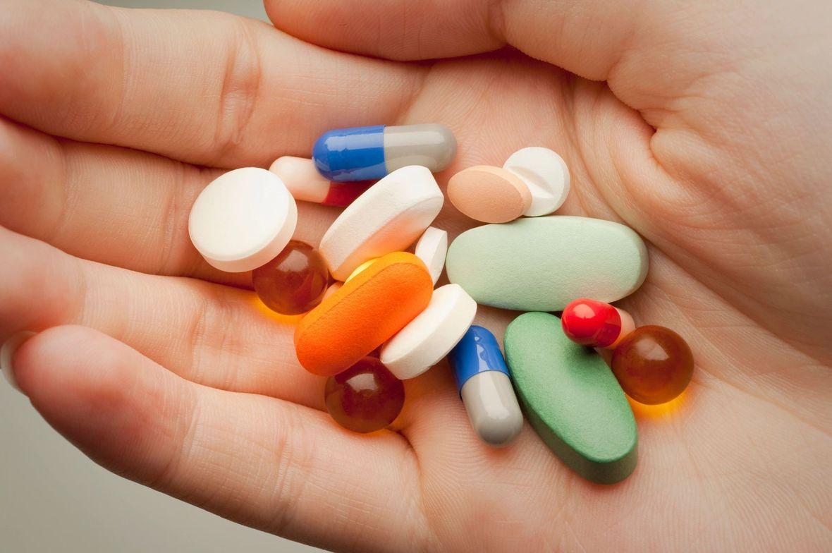 Pills in hand - 14775