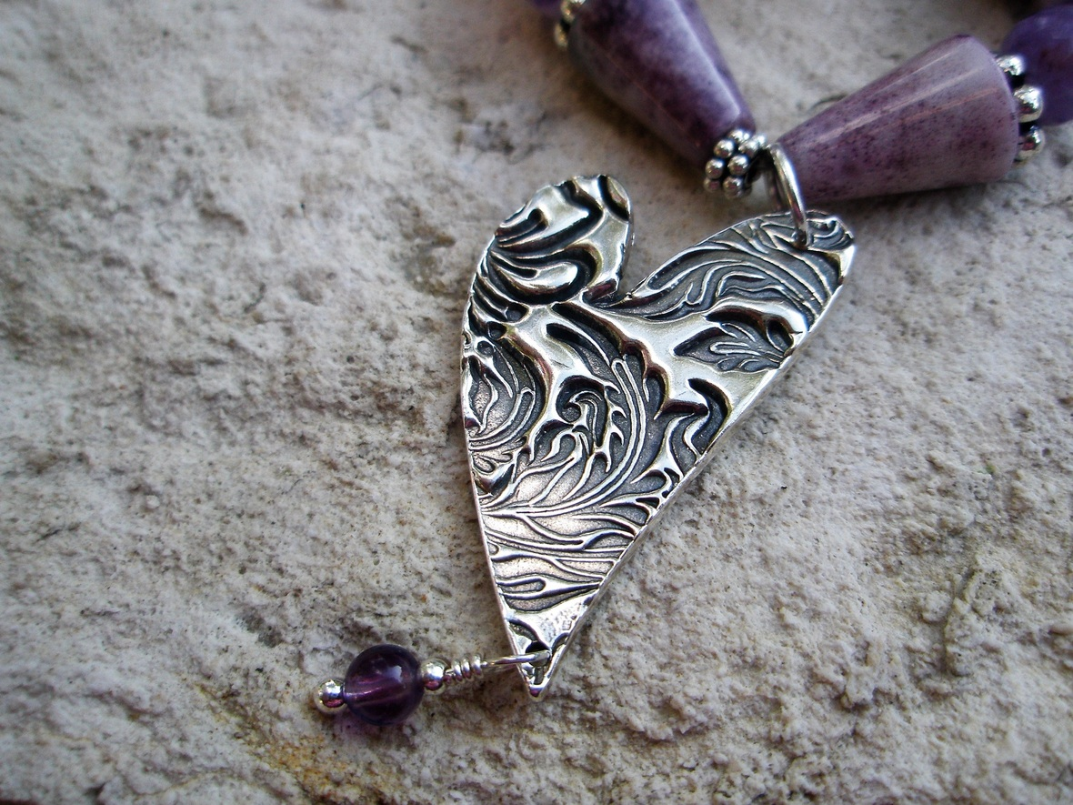 Detail of cast Sterling Silver heart on purple necklace 2