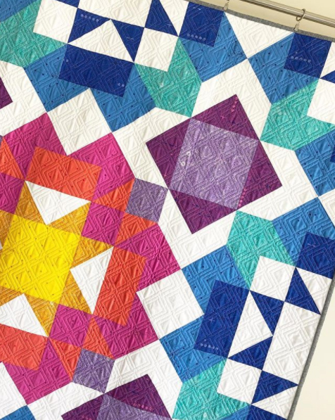 Tiedwitharibbon aurora quilt