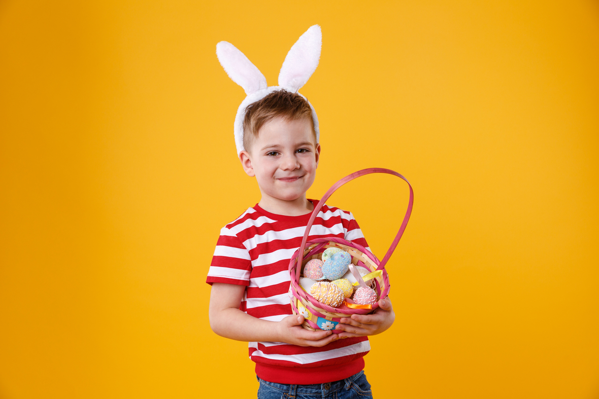 graphicstock-portrait-of-a-happy-satisfied-little-kid-wearing-bunny-ears-and-holding-easter-basket-full-of-colorful-eggs-isolated-over-orange-background HOn-npYtTl