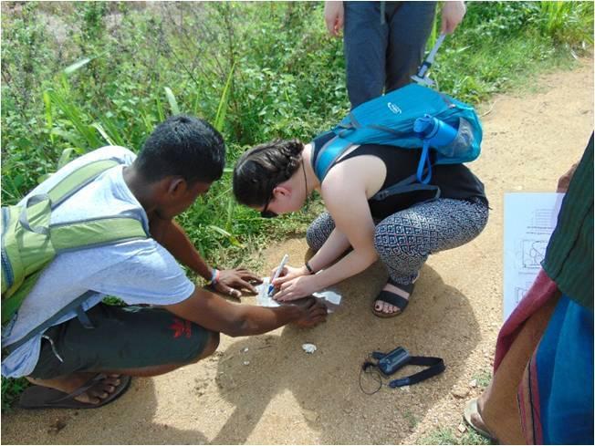 Sophie Omer Mcwalter Taking pug mark measurements