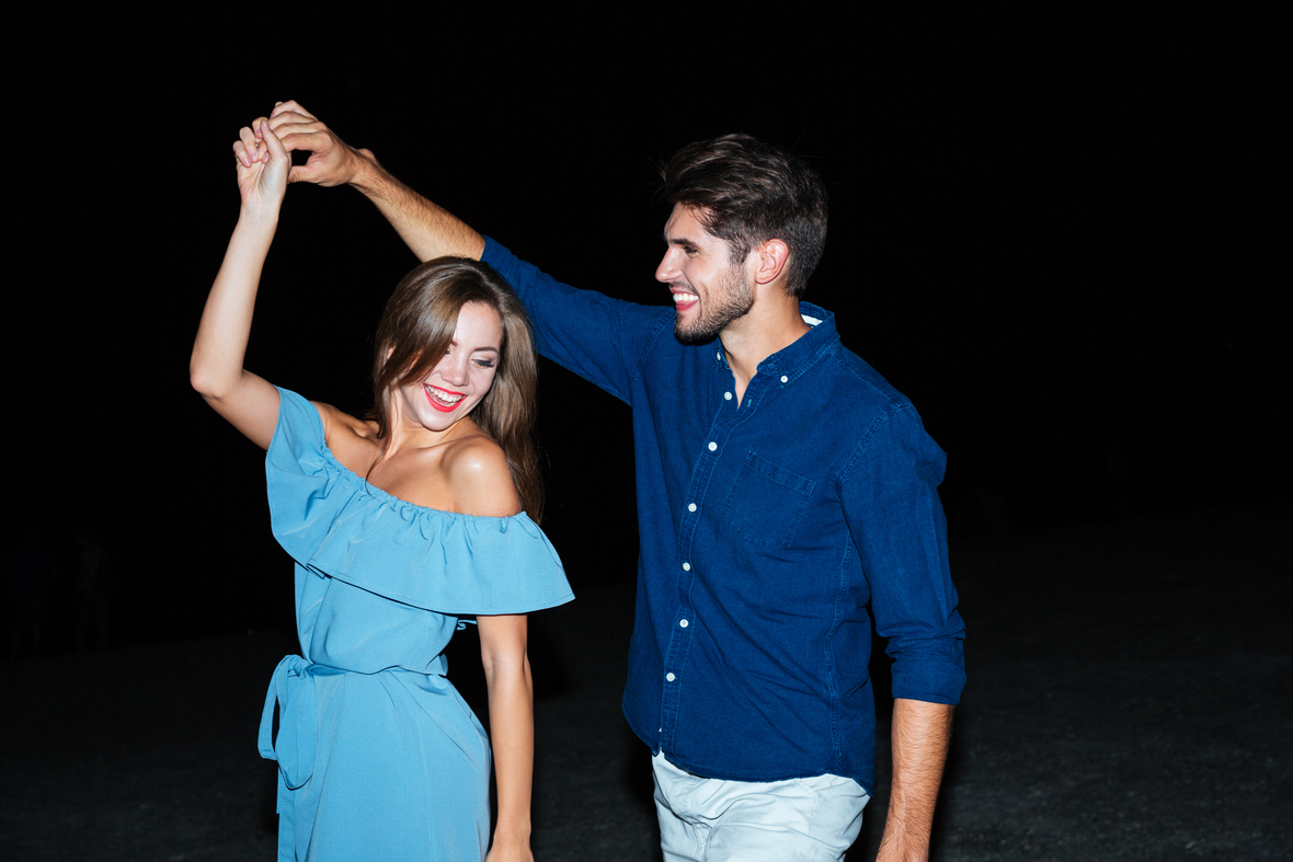 graphicstock-happy-young-couple-dancing-together-at-night BuWiIjirhx