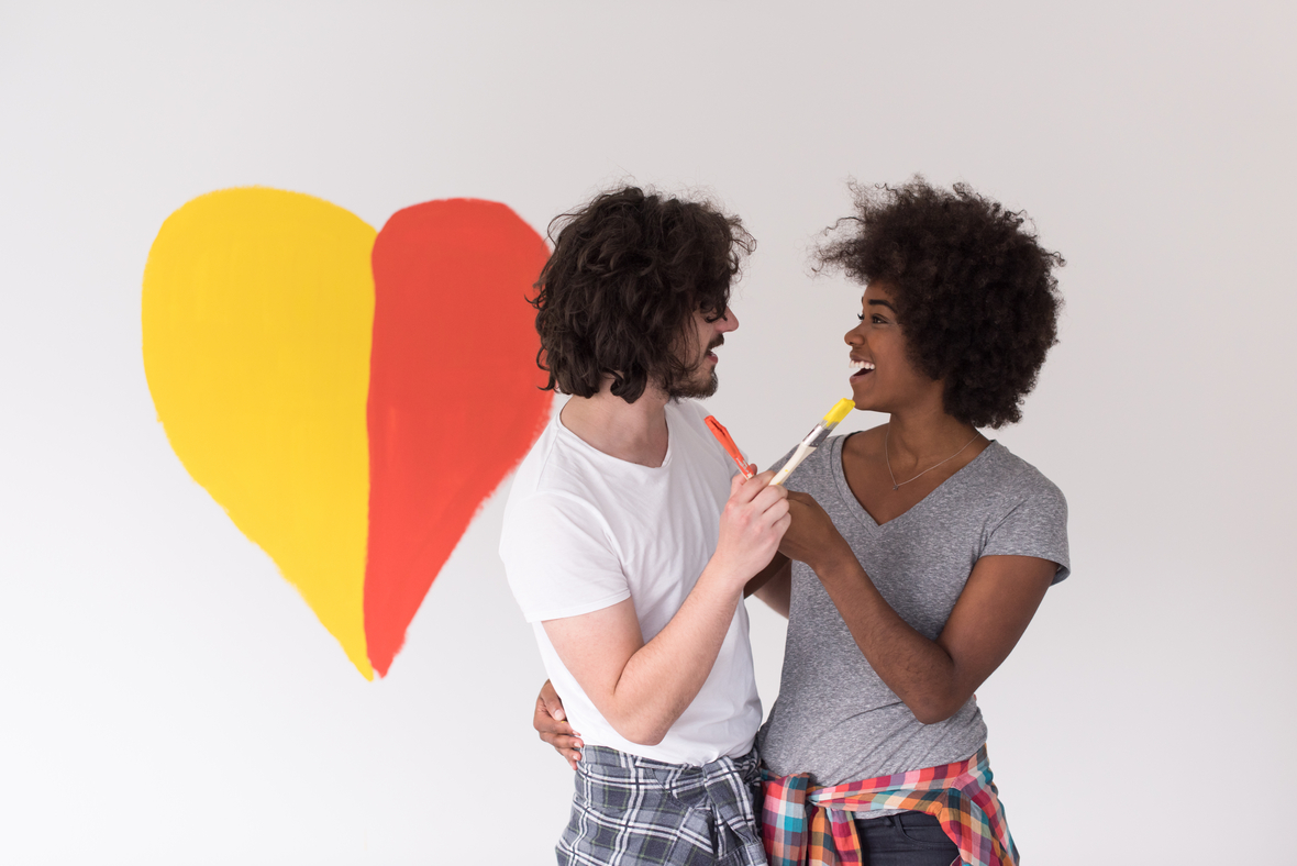 storyblocks-portrait-of-loving-multiethnict-couple-with-painted-heart-on-wall ruKNFTps-