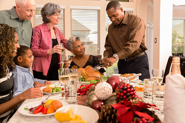 relationships-family-friends-gather-for-christmas-dinner-or-holiday-picture-id513184809