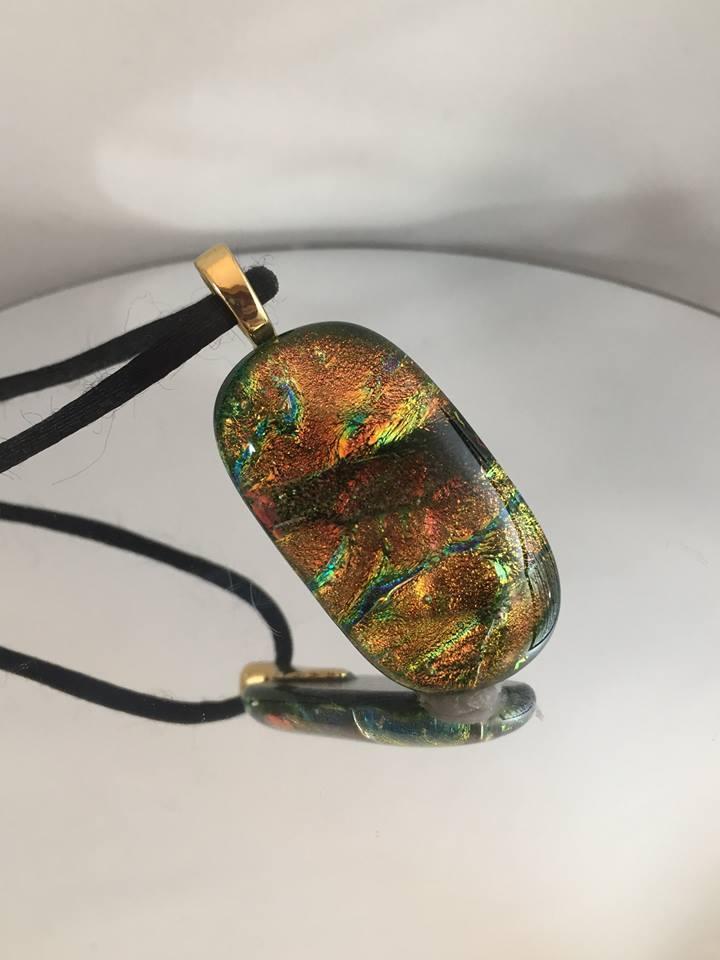 gold pendant posed