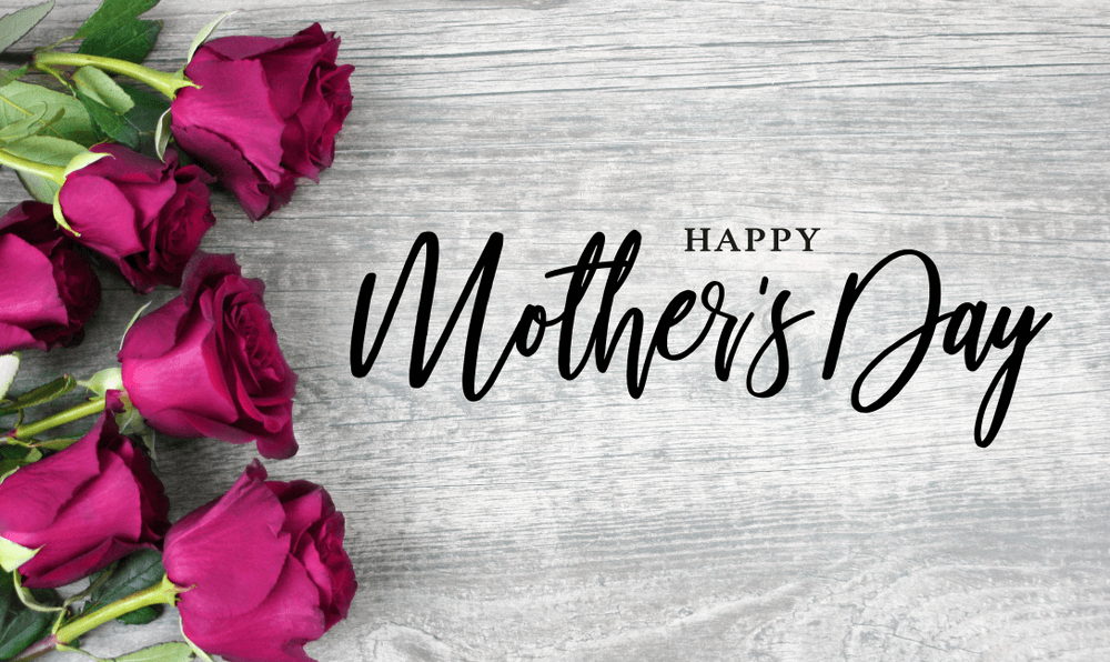 Happy-Mothers-Day-Calligraphy-with-Pink-Roses-Over-Rustic-Wood-Background-1